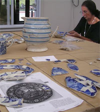 Photo with woman working on transferware