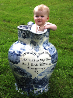 Toddler standing  in large mug