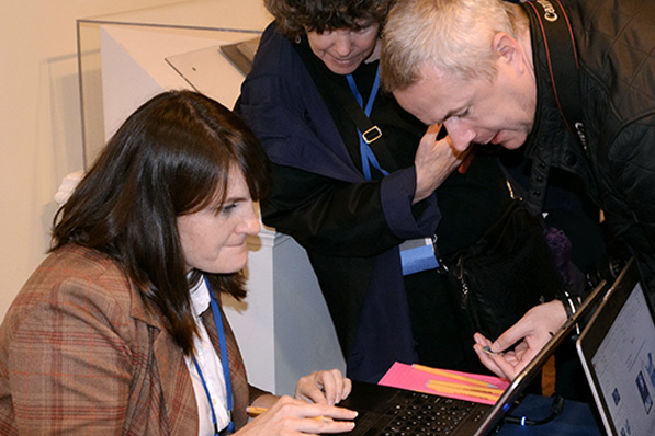 researchers looking at info on a computer